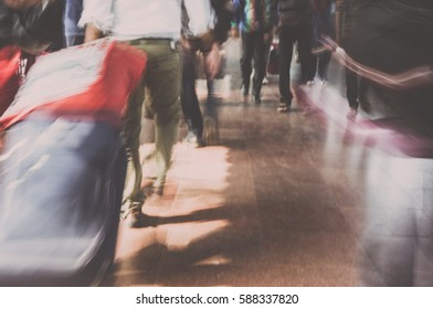 Blurry image of people in casual cloth walking in train station in India
