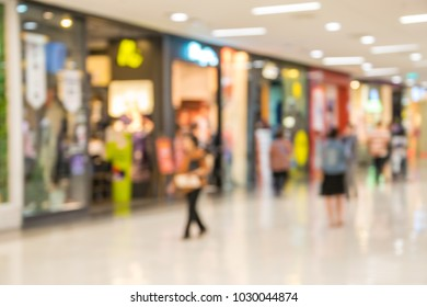 blurry image people man and woman walking in shoppingmall center