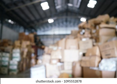Blurry image of poorly organized warehouse with a lot of messy stocks and boxes