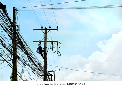 blurry image of professional technicians are fixing  Regarding the malfunction of the electrical system on a high pole in the atmosphere of the sky with the sun's rays  Advancement in technology