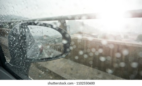 Blurry image of rain drops over glass window with light leaks