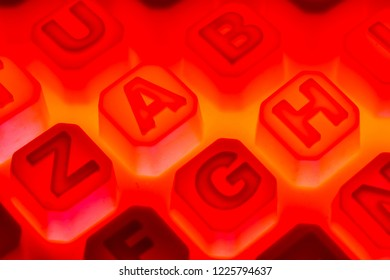 Blurry image of Red alphabet for background