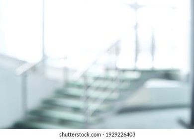 blurry image of a staircase in an office building .