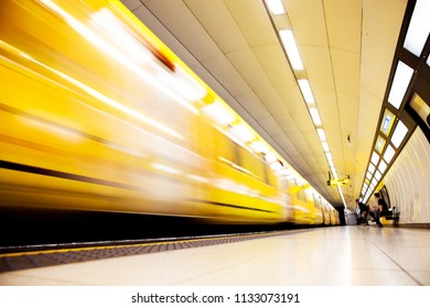 Blurry image of a subway station.