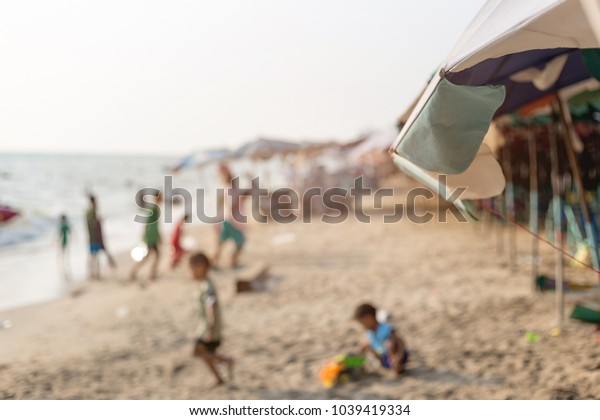 Blurry images of children playing beach , Blurred background