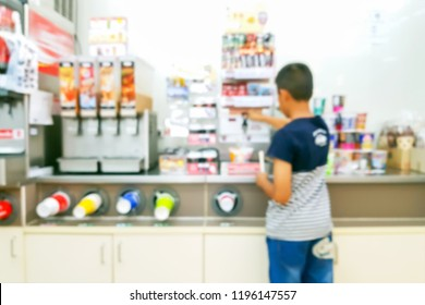 Blurry images inside the convenience store. Customers are shopping happily.