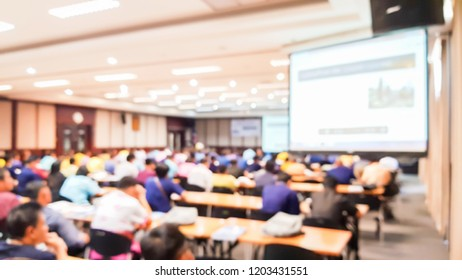 Blurry images in the large conference room.
