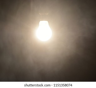 A blurry incandescent white bulb with smoky background unique photo