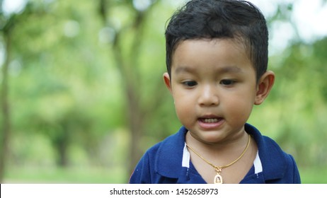 Blurry kid face not focus concept Close up of Asian boy showing feeling, isolated on blur background , boy 1.5 year old or 17 month show his teeth concept.
