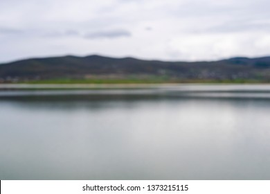 Blurry lake and village scenery, landscape view