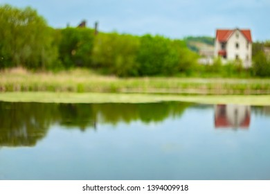Blurry landscape background. Sky reflected in water. Blurred spring backdrop. Shiny day out of focus. Hollidays in the village. Summertime backdrop for poster. Summer noon. Sky reflected in water.