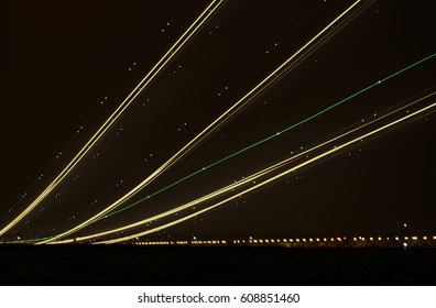 Blurry lights of aircraft on the glide path during night landings. Abstract background.