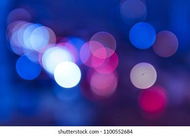 Blurry lights, circular illuminations, car traffic at night