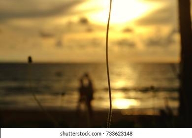 blurry lmage on sea beach with blur people ,sun set sky background