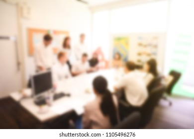 blurry many students is presentation project of assignment to professor in the meeting room at university.