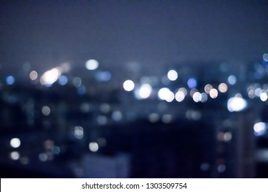 Blurry metropolitan district - night life, abstract background and modern dark tones concept. Big city comes alive at night