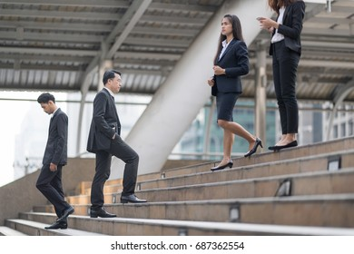 Blurry of Moment Businessman running fast upstairs. Horizontal outdoors shot.walking up stairs in city to success.