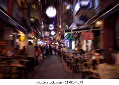 Blurry motion image of people walking on a street in Taksim /Beyoglu area at night in Istanbul. Location is a busy nightlife, shopping and dining district.