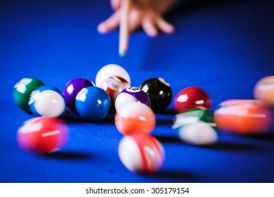 blurry and moving of billiard balls in a blue pool table