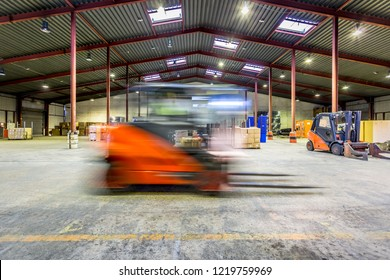 blurry moving forklift in a warehouse