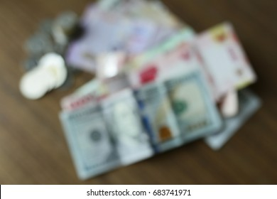 Blurry muti country money currency compare for money exchange rate Dollar Thai baht and Indonasin Rupiah