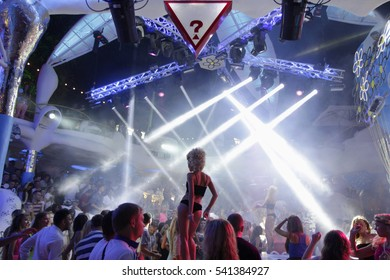 Blurry night club dj party people enjoy of music dancing sound with colorful light. club night light dj party Ibiza club. With Smoke Machine and Go Go dancer.