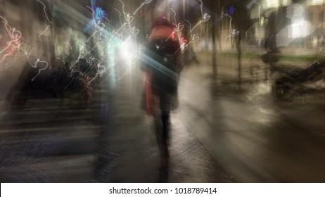 blurry night street people