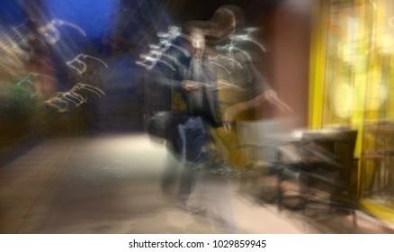 blurry night walking man