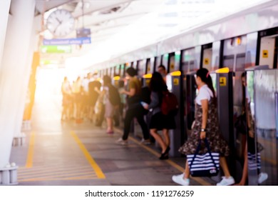 Blurry of, The passengers walking to the inside skytrain. The passengers walking out form the  skytrain.