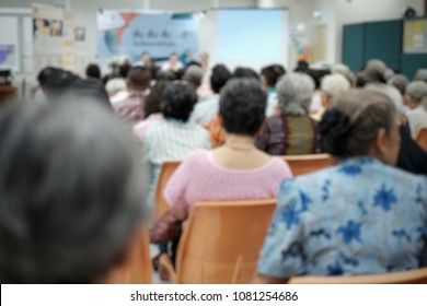 Blurry old people in the seminar event. Many elderly in the conference room. Concept of seniors seminar , health care and medical
