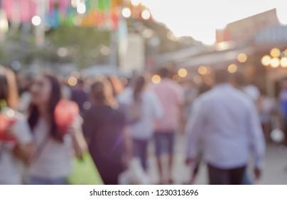 Blurry people on street.