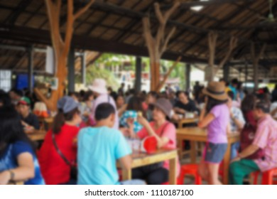 blurry people in restaurant.