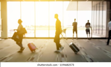 Blurry of people walking in airport terminals.