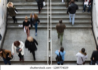 Blurry photo of people walking up and down the stairs in metro station in Athens