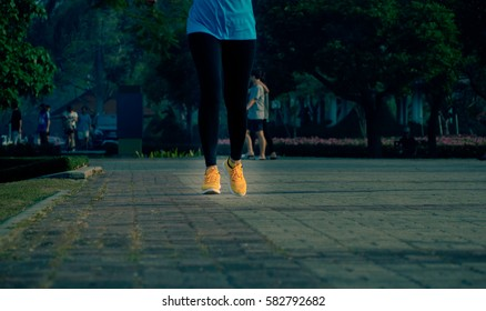 Blurry Picture of asian woman  are Running in Outdoor Public Park Background - Lifestyle Sport Recreation Concept