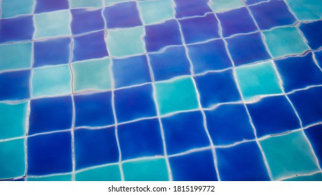 blurry pool tiles under water, wavey blue tiles background