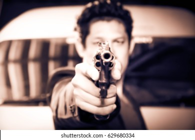 Blurry portrait man with gun  shooting, Bodyguard, Killer,Gunman,Vintage sepia
