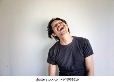 Blurry portrait of psychotic man standing in room,Mental illness