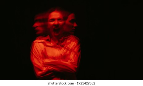 blurry portrait of a schizophrenic woman with paranoid disorders and bipolar disease on a dark background