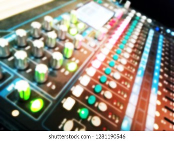 Blurry of power mixer background, Dj mixing in nightclub at party, defocused backdrop, Mixing console of a big HiFi system, The audio equipment, control panel of digital studio mixer. Audio mixer