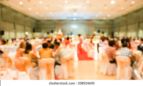 Blurry scene of Chinese round table feast in wedding ceremony.