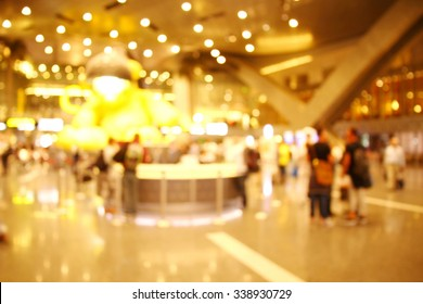 The blurry scene of the duty free shop in terminal hall among the colorful light decoration represent the travel industry concept airport atmosphere concept related idea.