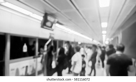 Blurry scene of passengers waiting the electric train inside subway - Urban and city lifestyle concept - Black and White