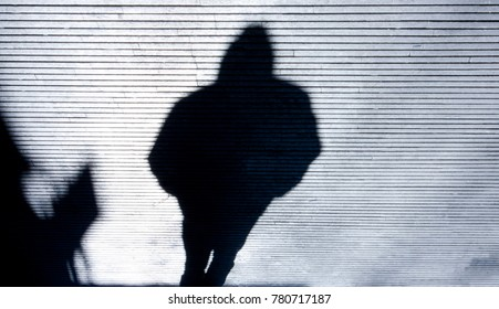Blurry shadow of a person wearing a hood walking city street in black and white & Alone In Shadow Images Stock Photos u0026 Vectors | Shutterstock