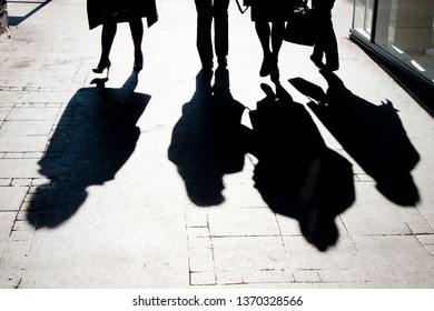 Blurry shadow silhouette of  people walking on city pedestrian street in high contrast black and white