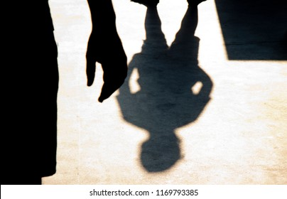 Blurry shadow silhouette of two boys confronting each other in school yard