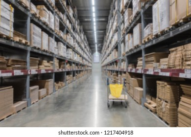 Blurry shelf in the warehouse with the cart for background.