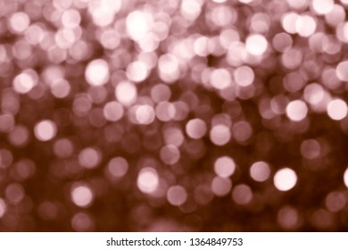 Blurry shiny copper glitter textured background