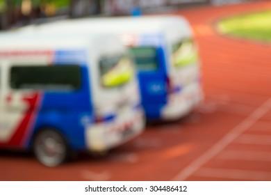 Blurry shot of emergency ambulance car in the football stadium.