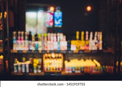 Blurry showcase in vape shop close up. Blurred showcase with the goods.